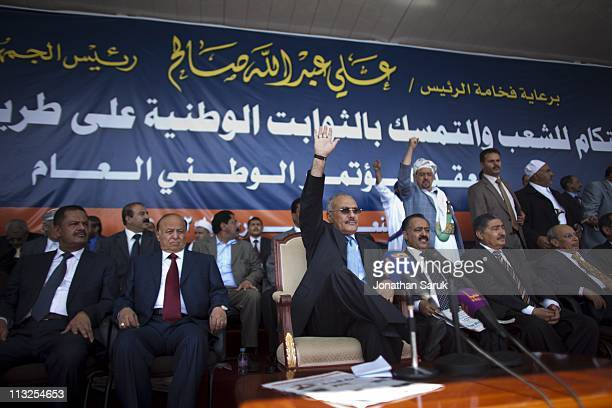 President Ali Abdullah Saleh waves to his supporters before a giving a speech March 10 2011 in Sana Yemen Thousands of Yemenis have been protesting...