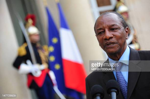 President Alpha Conde of Guinea answers journalists questions following a meeting with French president at the Elysee presidential palace in Paris,...