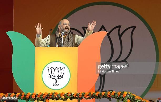 BJP president Amit Shah addresses during the 'Abhinandan rally' at Ramlila Maidan on January 10 2015 in New Delhi India Prime Minister Narendra Modi...