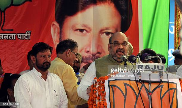 BJP president Amit Shah addressing a rally after twotime Congress MP and former minister Lal Singh joined BJP on August 25 2014 at Kathua about 80 km...