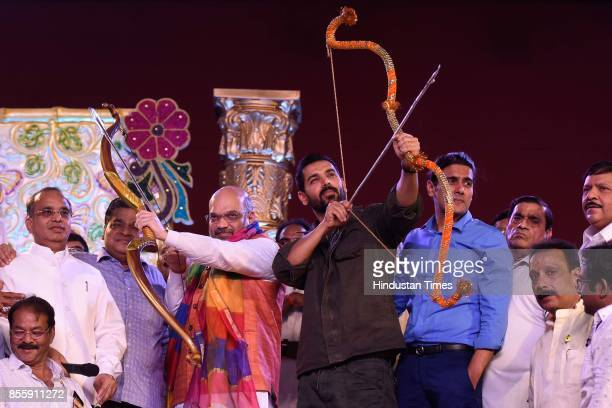President Amit Shah and Bollywood actor John Abraham during the Dussehra festival celebration at Lal Quila Grounds on September 30 2017 in New Delhi...