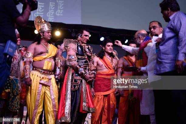 President Amit Shah and Bollywood actor Mukesh Rishi during the Dussehra festival celebration at Lal Quila Grounds on September 30 2017 in New Delhi...