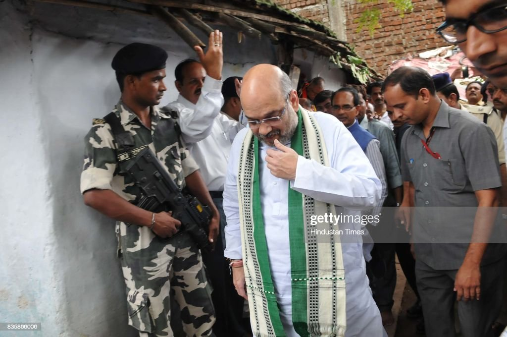 BJP President Amit Shah coming out after having lunch at the residence of tribal Kamal Singh Uike, who belongs to Gond tribal community, on August 20, 2017 in Bhopal, India. Shah had lunch at the residence of a tribal worker as part of the BJP's outreach programme to strengthen the bond with the socially-oppressed classes.