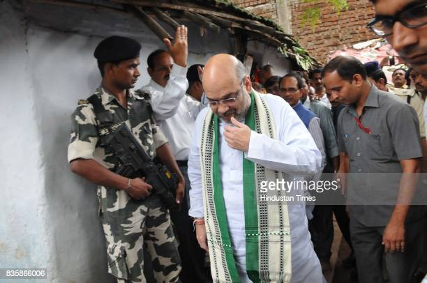 President Amit Shah coming out after having lunch at the residence of tribal Kamal Singh Uike who belongs to Gond tribal community on August 20 2017...