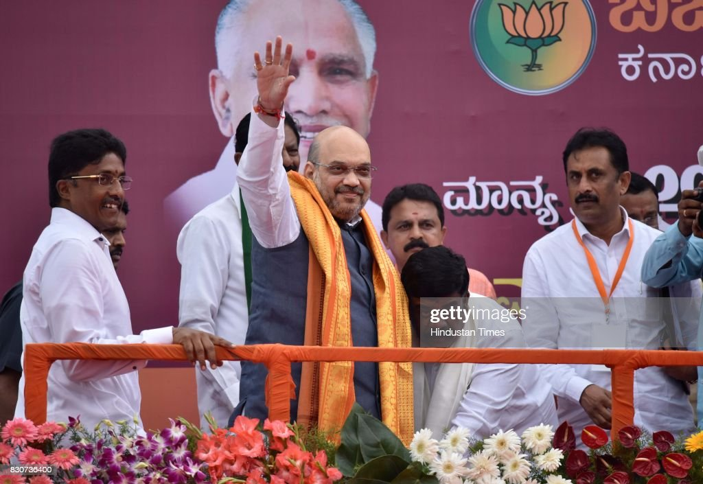 BJP President Amit Shah during a public rally near Devanahalli, on August 12, 2017 in Bengaluru, India. Shah is on a three-day visit to Karnataka starting Saturday as part of his 110-day nationwide tour to strengthen the party. Shah said that he had come here to realise the resolution of forming the next BJP government in Karnataka.