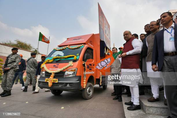 President Amit Shah flags off NaMo Rath from BJP Headquarters at Deendayal Upadhyaya Marg on March 4, 2019 in New Delhi, India. The saffron coloured...