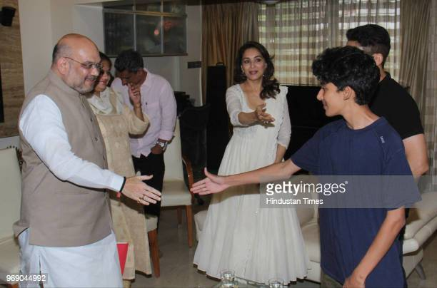 President Amit Shah meets Bollywood actor Madhuri Dixit with her husband Sriram Nene at her residence as part of his party's Sampark se Samarthan...