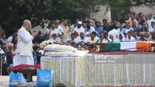 President Amit Shah pays his final respects during the cremation ceremony of former Prime Minister Late Atal Bihari Vajpayee at Rashtriya Smriti...