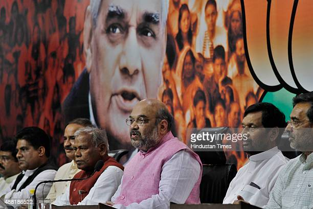 President Amit Shah with HAM Chief Jitan Ram Manjhi and LJP President Ram Vilas Paswan addresses a press conference regarding Bihar elections on...