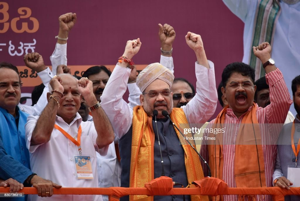 BJP President Amit Shah with Karnataka BJP state President BS Yeddyurappa and Union Minister Ananth Kumar during a public rally near Devanahalli, on August 12, 2017 in Bengaluru, India. Shah is on a three-day visit to Karnataka starting Saturday as part of his 110-day nationwide tour to strengthen the party. Shah said that he had come here to realise the resolution of forming the next BJP government in Karnataka.