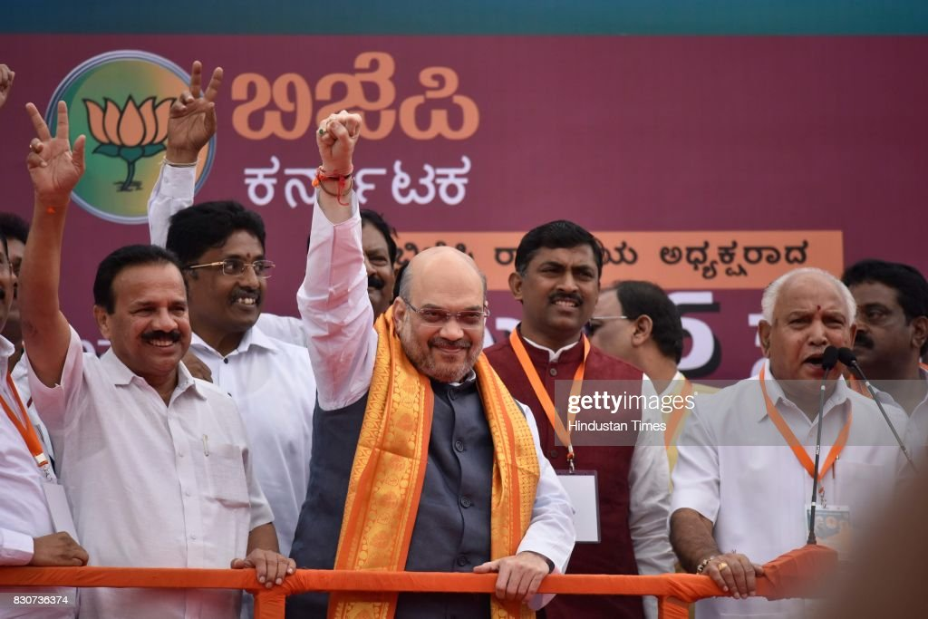 BJP President Amit Shah with Karnataka BJP state President BS Yeddyurappa and Union Minister Sadanand Gowda during a public rally near Devanahalli, on August 12, 2017 in Bengaluru, India. Shah is on a three-day visit to Karnataka starting Saturday as part of his 110-day nationwide tour to strengthen the party. Shah said that he had come here to realise the resolution of forming the next BJP government in Karnataka.