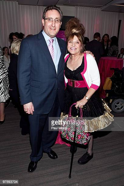 President and CEO Andrew Imparato poses for a photo with Cheryl Sensenbrenner at An Evening with Betsey Johnson hosted by the AAPD at the Recording...