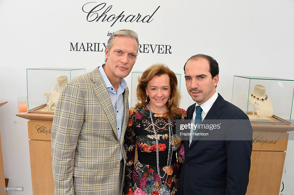 President and CEO at Chopard U.S. Marc Hruschka, Caroline Scheufele and Alexis Veller attend the Chopard and W Magazine 'Marilyn Forever' exhibition at Soho Beach House on December 6, 2012 during Art Basel Miami in Miami Beach, Florida.