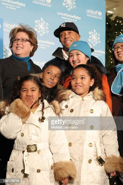 President and CEO Carol Stern music mogul Russell Simmons Aoki Lee Russell 'Russy' Simmons Ming Lee and UNICEF/Pier 1 Card Winners Josephine Kao and...