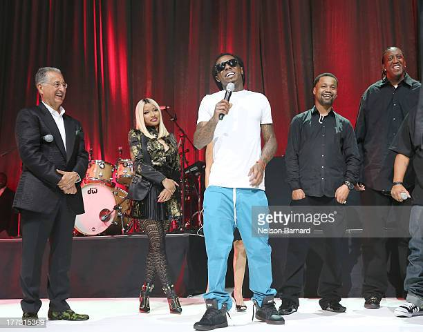 President and CEO Del Bryant Nicki Minaj Lil Wayne Juvenile and Slim Williams speak onstage at the 2013 BMI RB/HipHop Awards at Hammerstein Ballroom...