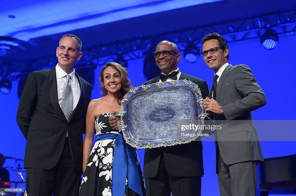 BMI President and CEO Mike O'Neill, BMI Vice President Delia Orjuela, Sergio George and Marc Anthony onstage at BMI's 22nd Annual Latin Music Awards at Fountainbleau Miami Beach on March 31, 2015 in Miami Beach, Florida.