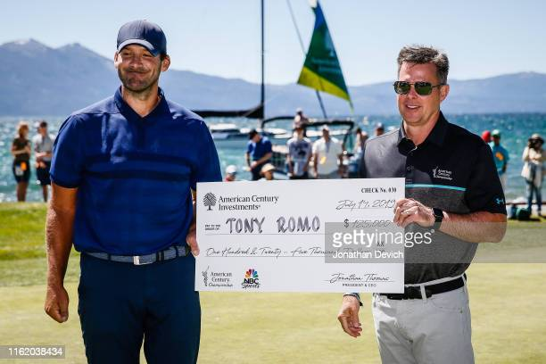 President and CEO of American Century Investments Jonathan Thomas presents American Century Championship winner Tony Romo with the winner's check at...
