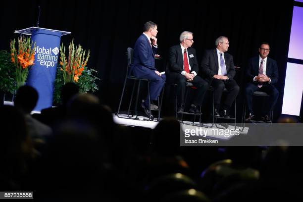President and CEO of American Gaming Association Geoff Freeman moderates a panel discussion with Michael Rumbolz President and CEO Everi Craig Clark...