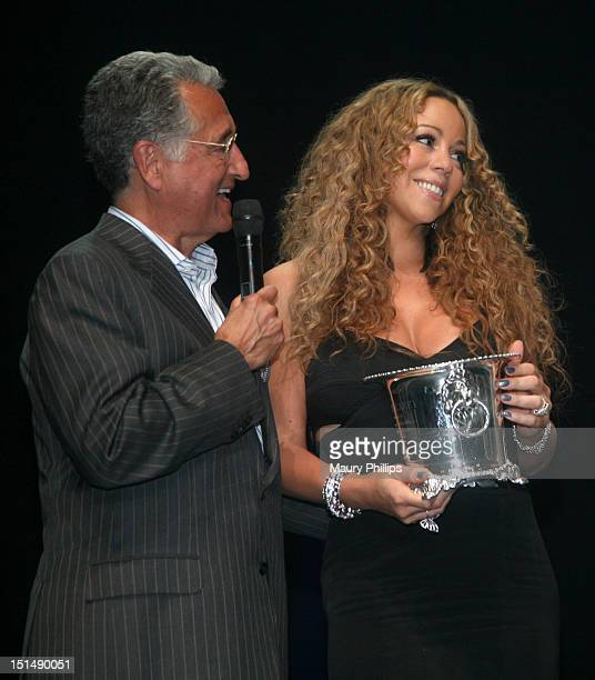 President and CEO of BMI Del Bryant presents honoree Mariah Carey with the BMI Icon Award onstage during the 2012 BMI Urban Awards honoring Mariah...