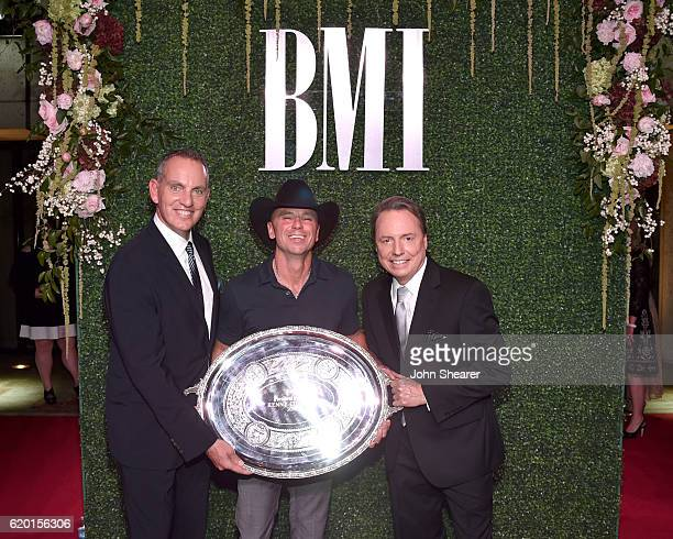 President and CEO of BMI Mike O'Neill SingerSongwriter Kenny Chesney and Vice President of WriterPublisher Relations Jody Williams attend the 64th...