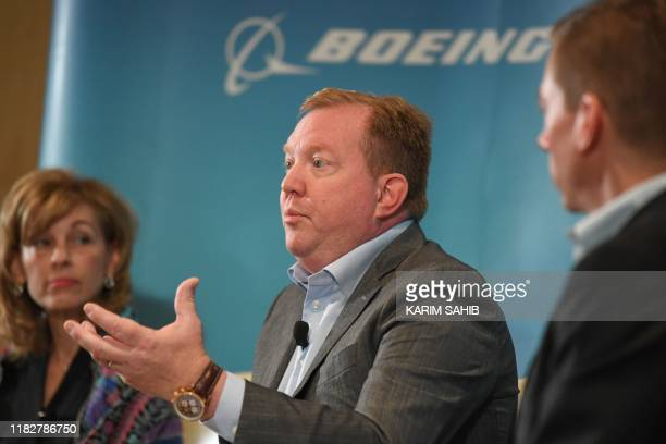 President and CEO of Boeing Defense Space and Security Leanne Caret listens to President and CEO of Boeing Commercial Airplanes Stan Deal speaking...