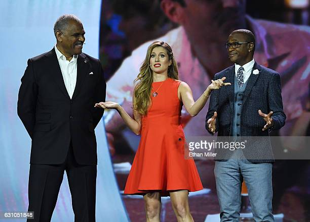 President and CEO of Carnival Corp Arnold W Donald and television personalities Andrea Feczko and Tommy Davidson speak during Donald's keynote...