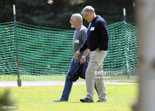 President and CEO of Chubb Limited Evan Greenberg and Co-founder of Microsoft Bill Gates walk together following a session at the Allen & Company Sun...