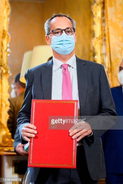 President and CEO of GE Renewable Energy Jerome Pecresse poses during a contracts and economic agreements signing ceremony at the Hotel de Matignon...