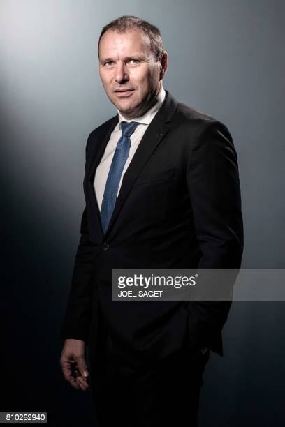 President and CEO of German news agency DPA Peter Kropsch poses during a photo session in Paris on July 6 2017 / AFP PHOTO / JOEL SAGET
