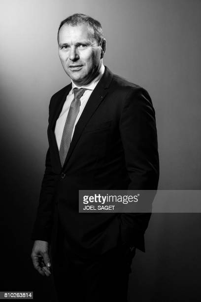 President and CEO of German news agency DPA Peter Kropsch poses during a photo session in Paris on July 6 2017 / AFP PHOTO / JOEL SAGET / BLACK AND...