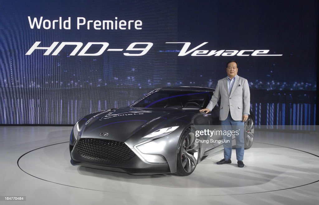 President and CEO of Hyundai Motors Kim Choong-Ho poses next to a Hyundai HND-9 Venace at the Seoul Motor Show 2013 on March 28, 2013 in Goyang, South Korea. The Seoul Motor Show 2013 will be held in March 29-April 7, featuring state-of-the-art technologies and concept cars from global automakers. The show is its ninth since the first one was held in 1995. About 384 companies from 14 countries, including auto parts manufacturers and tire makers, will set up booths to showcase trends in their respective industries, and to promote their latest products during the show.