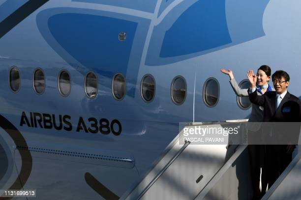 President and CEO of Japanese airline All Nippon Airways Holdings Shinya Katanozaka waves during a ceremony for the delivery of the company's first...