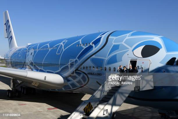 President and CEO of Japanese airline All Nippon Airways Holdings Shinya Katanozaka and President of Airbus Japan Stephane Ginoux wave during a...