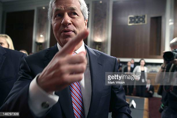 President and CEO of JPMorgan Chase Co Jamie Dimon walks away after testyfing before a Senate Banking Committee hearing on Capitol Hill June 13 2012...
