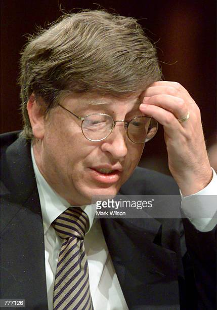 President and CEO of Microsoft Bill Gates speaks during a US Senate Joint Economic Committee meeting June 7 in Washington DC Gates and other CEO's...