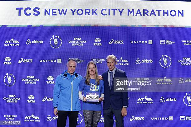 President and CEO of New York Road Runners, Michael Capiraso, teacher Jacquelyn Mahoney and president of events New ayork Road Runners race director,...