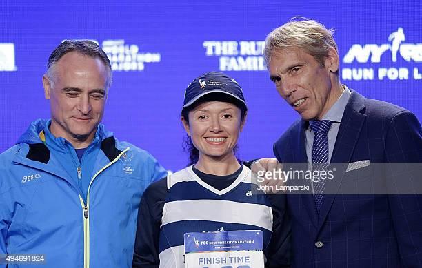 President and CEO of New York Road Runners, Michael Capiraso, volunteer pacer, Julia Khavasechko and president of events New ayork Road Runners race...