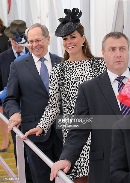 President and CEO of Princess Cruises Alan Buckelew escorts Catherine Duchess of Cambridge as she walks down the gangplank disembarking the Royal...