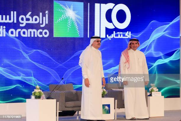 President and CEO of Saudi Aramco Amin Nasser and Aramco's chairman Yasir alRumayyan attend a press conference in the eastern Saudi Arabian region of...