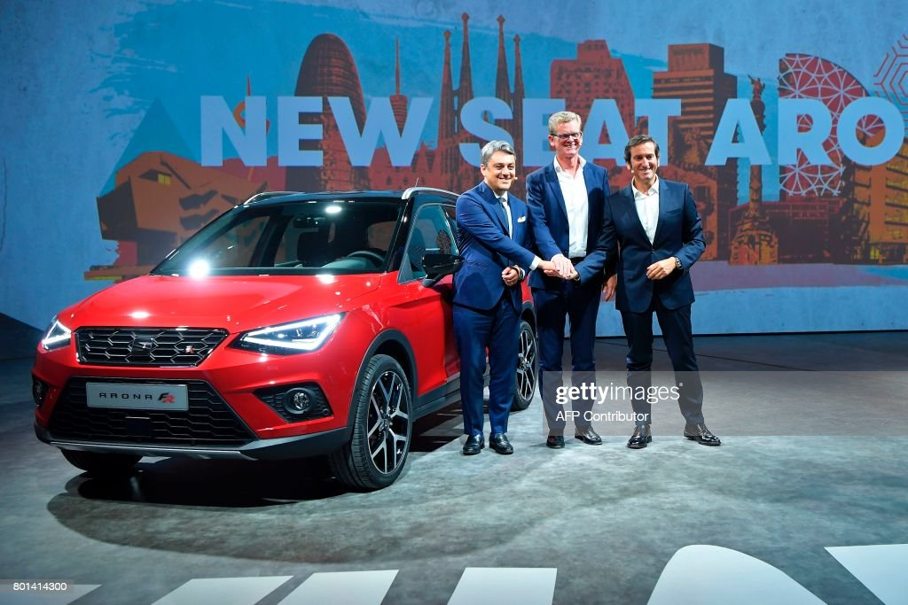 President and CEO of Seat, Luca de Meo (L), Executive Vicepresident for Research and Developement of Seat Dr. Matthias Rabe (C) and director of Design of Seat Alejandro Mesonero pose during the international presentation of the new SEAT Arona, in Barcelona on June 26, 2017. /