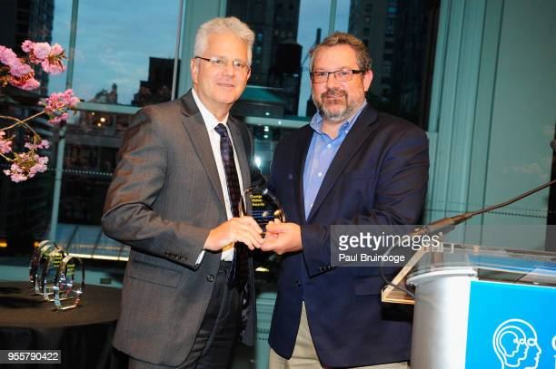 President and CEO of the Brain and Behavior Resarch Foundation Dr Jeff Borenstein accepts the Outstanding Organization Award from Director of the...