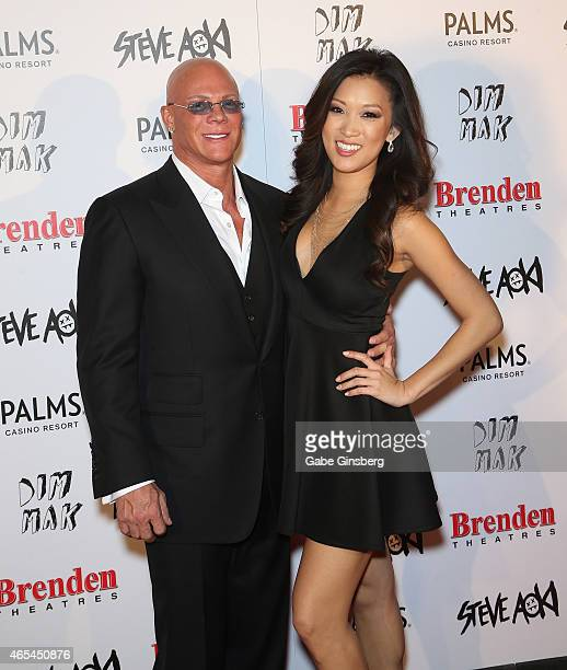 President and CEO of the Brenden Theatre Corp Johnny Brenden and a guest attend the Brenden Celebrity Star unveiling honoring Steve Aoki at the...