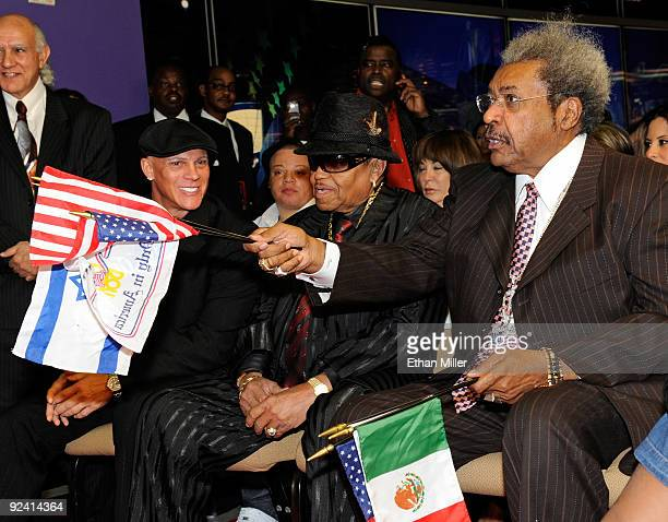 President and CEO of the Brenden Theatre Corp Johnny Brenden Joe Jackson and boxing promoter Don King appear during the unveiling of a celebrity star...
