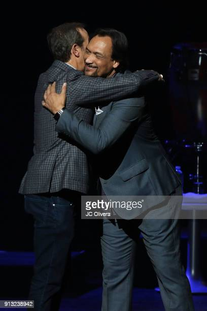 President and CEO of The Conga Room Brad Gluckstein and Jimmy Smits speak onstage during The Conga Room's 20th Anniversary Salsa Extravaganza at...