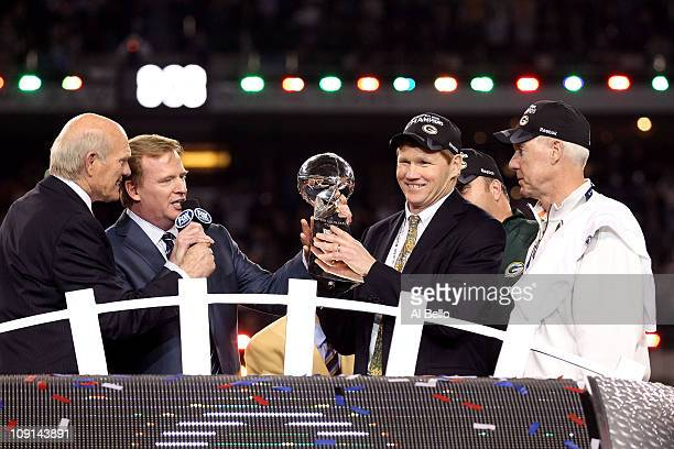 President and CEO of the Green Bay Packers Mark Murphy holds up the Vince Lombardi Trophy after winning Super Bowl XLV against the Pittsburgh...