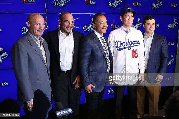 President and CEO of the Los Angeles Dodgers Stan Kasten Dodgers GM Farhan Zaidi Dave Roberts Pitcher Kenta Maeda and Dodgers president of baseball...