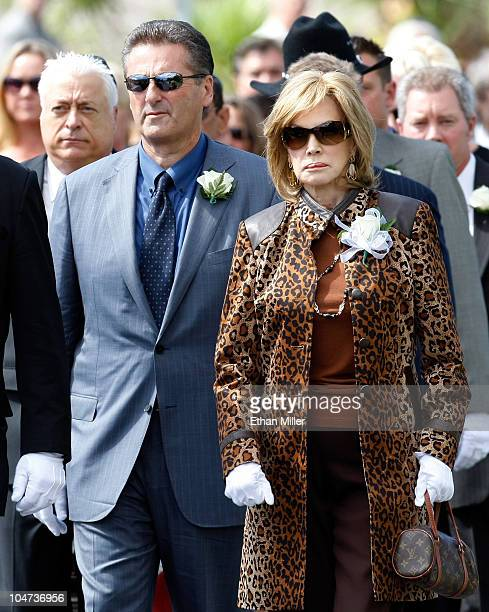 President and CEO of The Mirage Hotel Casino Felix Rappaport and singer Phyllis McGuire attend the funeral for actor Tony Curtis at Palm Mortuary...