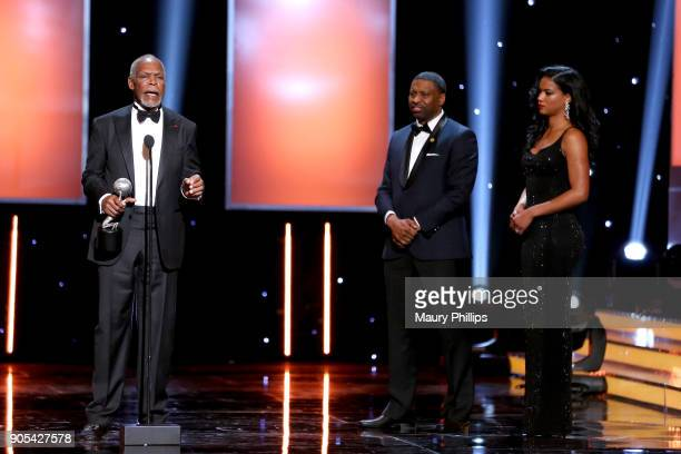 President and CEO of the NAACP Derrick Johnson listens to honoree Danny Glover accept the President's Award onstage during the 49th NAACP Image...