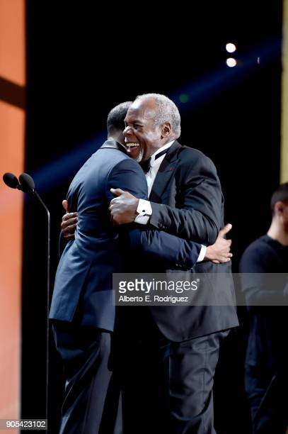 President and CEO of the NAACP Derrick Johnson presents the President's Award to honoree Danny Glover onstage during the 49th NAACP Image Awards at...