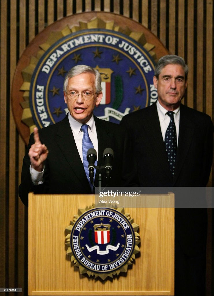 President and CEO of the National Center for Missing & Exploited Children Ernie Allen (L) speaks as FBI Director Robert Mueller (R) listens during a news conference at the FBI headquarters June 25, 2008 in Washington, DC. The news conference was to mark the 5th anniversary of Innocence Lost initiative.